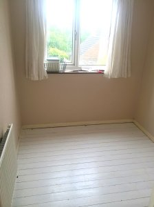Sewing room - white painted floor
